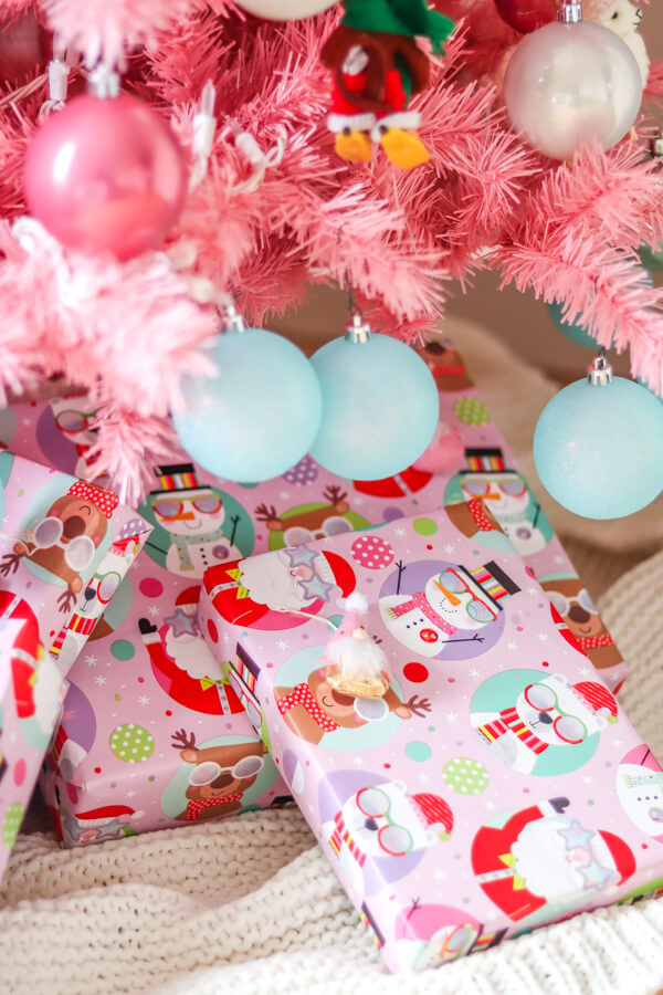 wrapped pink Christmas presents under a pink Christmas tree