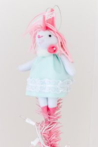 unicorn with pink hair and blue dress as a tree topper