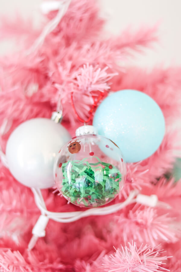 white ornament, light blue ornrament and homemade clear plastic ornament on pink Christmas tree