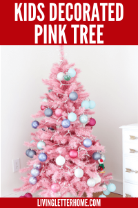 Letting your kids decorate their own tree is so fun! See this decorated pink Christmas tree!