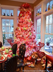 Large pink christmas tree decorated with Valentine's Day decor