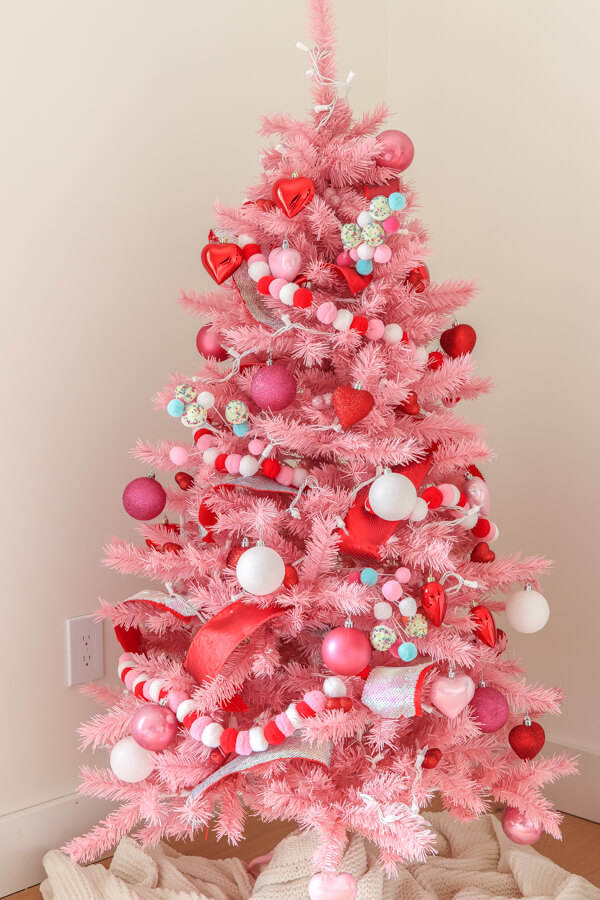 pink Christmas tree with Valentine's ornaments and decor