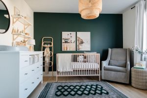 hunter green feature wall with IKEA light and light wood crib