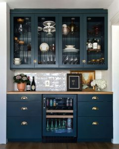 navy built in dry bar with white subway backsplash