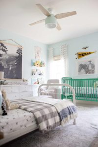 green Jenny Lind crib and white iron twin bed in shared room