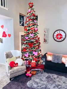 tall skinny green christmas tree decorated for Valentine's Day