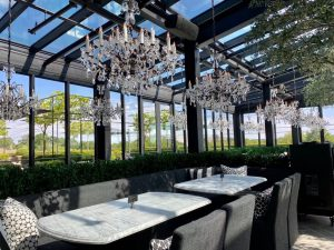 glass interior building with chandeliers RH in Charlotte, NC restaurant