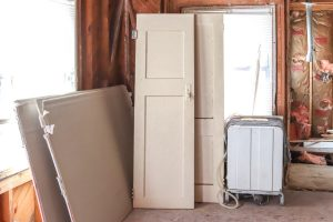 interior doors leaning up against a window and no drywall