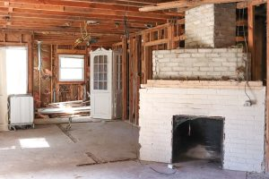 interior home framing with white brick fireplace