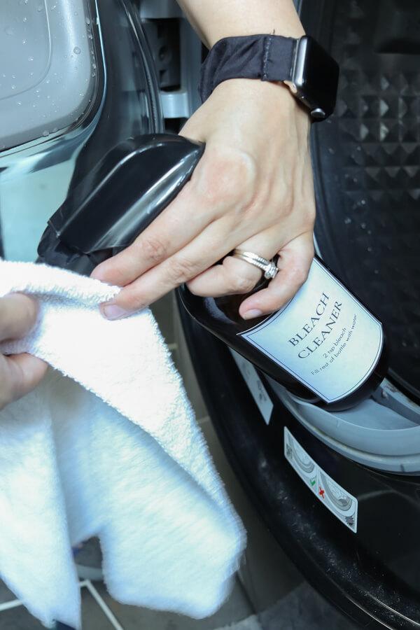 homemade bleach cleaner spraying a white cloth