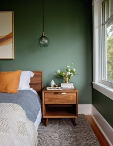 dark green bedroom accent wall with wood furniture