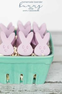Easter bunny purple heads in a green berry basket