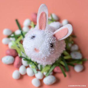 pom pom white Easter bunny head on orange background