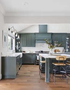 dark green kitchen cabinets painted in Sherwin Williams Pewter Green