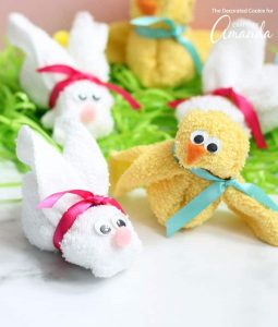 Bunny and chick made out of white and yellow wash cloths