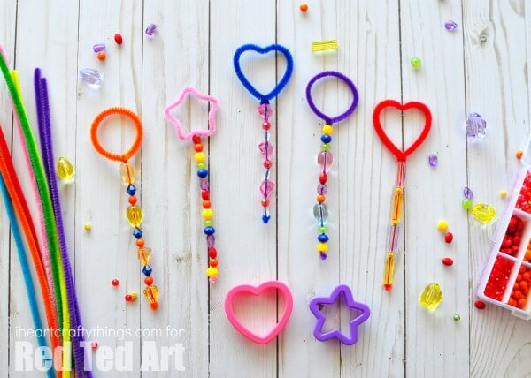 pipe cleaner bubble wands on shiplap background