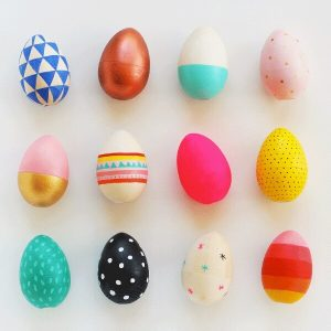 colorful wooden painted Easter eggs on white background