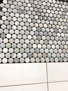 penny tile against white subway tile from Floor and Decor