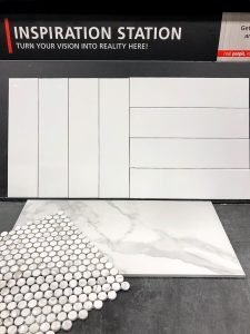 stacked white subway tile and white penny tile with large marble floor tiles from Floor and Decor