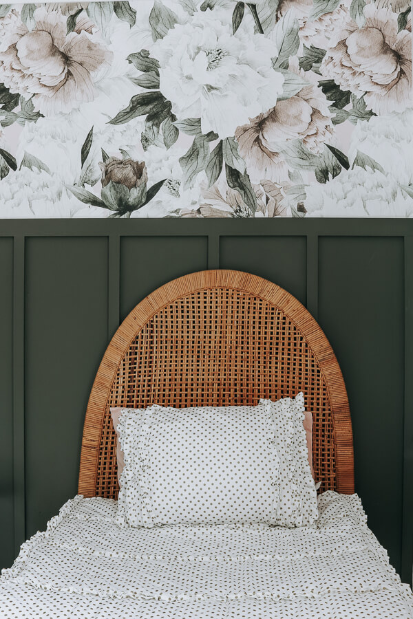 rattan headboard with floral wallpaper and Behr black bamboo feature wall