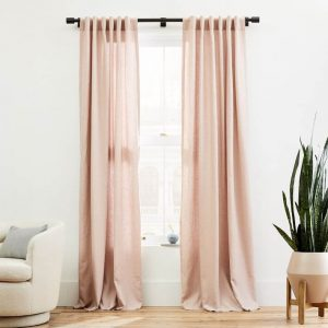 blush pink linen curtains with green plant