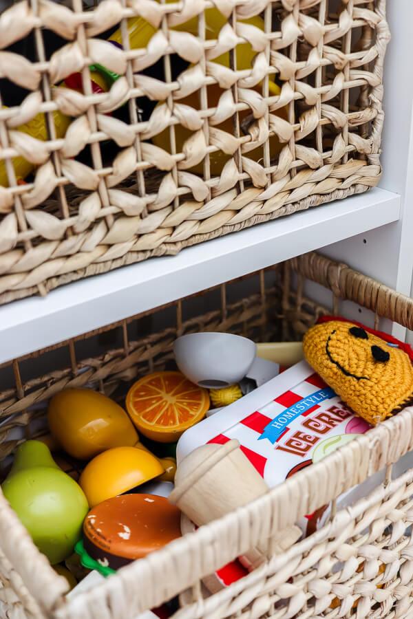 rattan toy storage basket with play food inside
