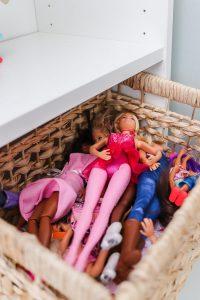 rattan toy storage basket with barbies inside