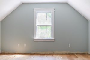 slanted wall in cape cod with wall painted Sherwin Williams Sea Salt