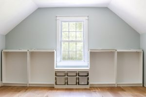 Ikea Billy white bookcase and white Trofast in playroom with Sherwin Williams Sea Salt wall
