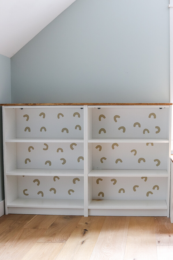 white Ikea Billy bookcases with wood top