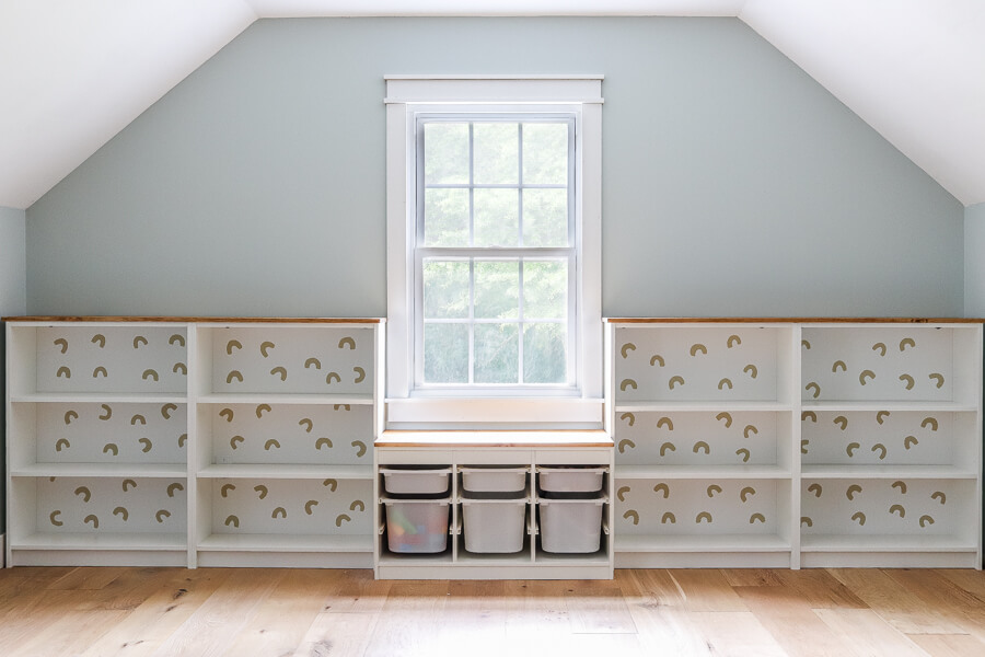 Ikea Billy bookcases and Trofast in white on playroom wall