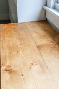 closeup of wood top on Ikea Trofast unit in white