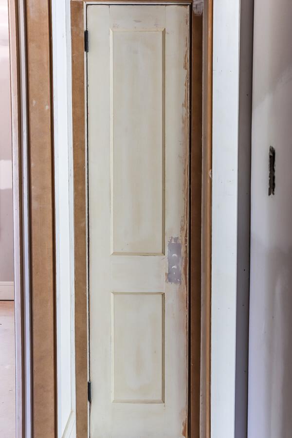 linen closet with original doors in investment property