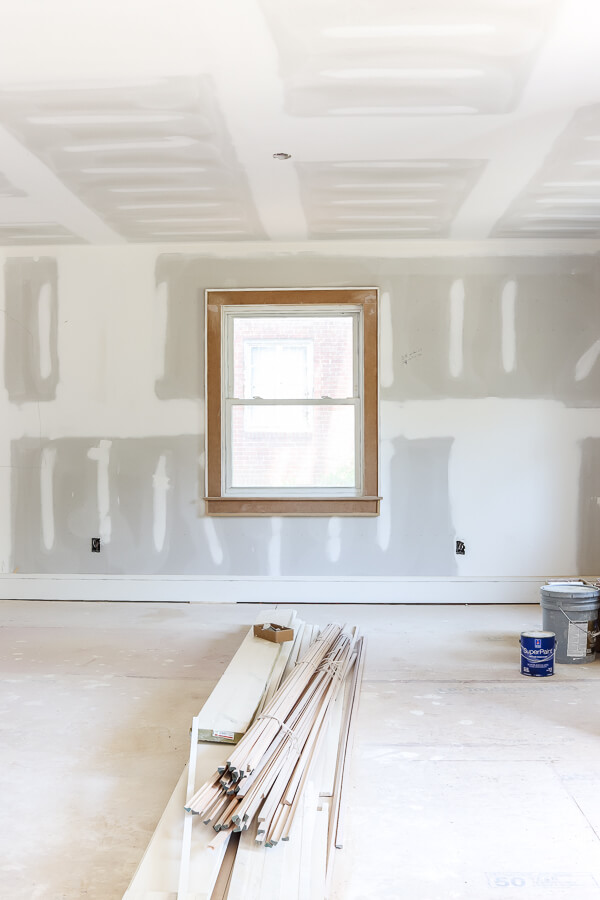 unpainted drywall with window in investment property flip house