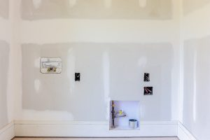 drywall in laundry room in investment property flip house