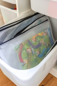 chutes and ladders board game in zipper pouch inside Ikea Trofast unit