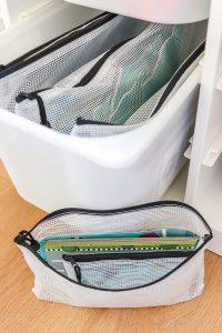 Chuckle and Roar game red light green light in zipper pouch inside Ikea Trofast unit