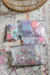 zipper bags on aztec rug with small toys inside