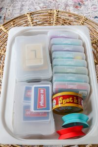 plastic tub with card games in plastic containers