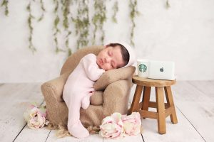 baby girl newborn photo sitting in chair with tiny starbucks cup and Macbook laptop from Charmarie Photography newborn photos