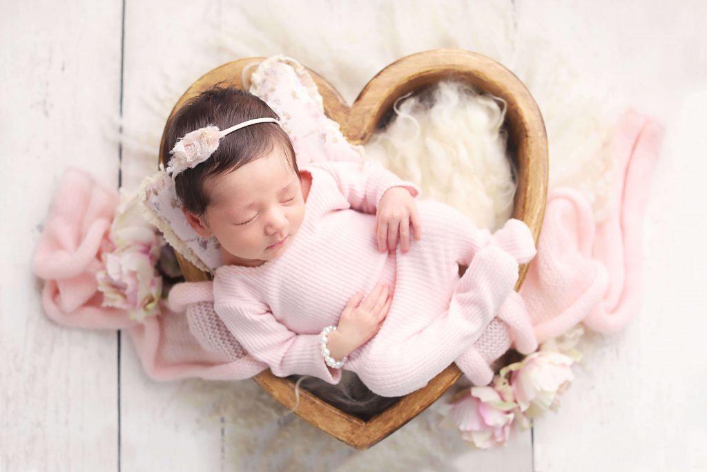 baby girl newborn photo in heart box wearing pink from Charmarie Photography newborn photos