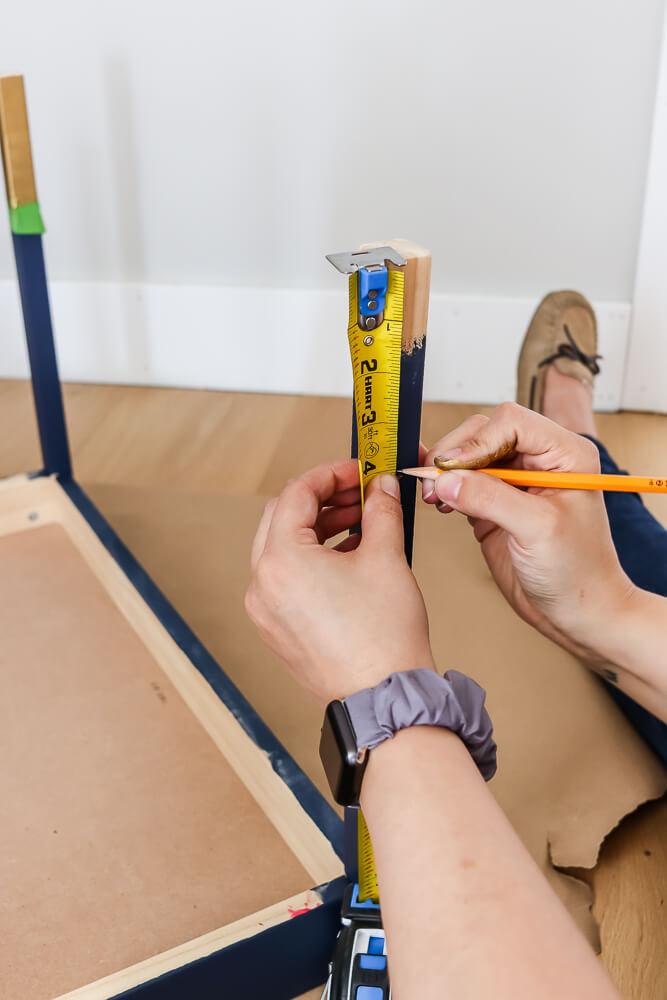 woman marking with pencil on Ikea latt table leg