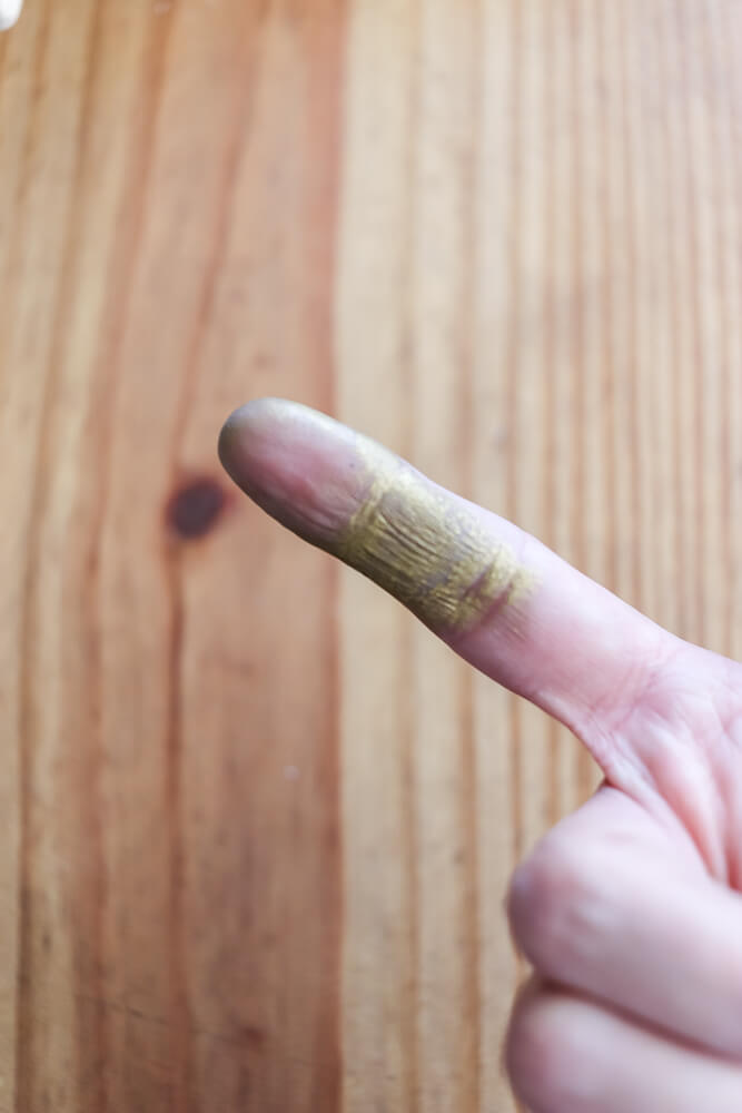 gold Rub n Buff on woman's finger