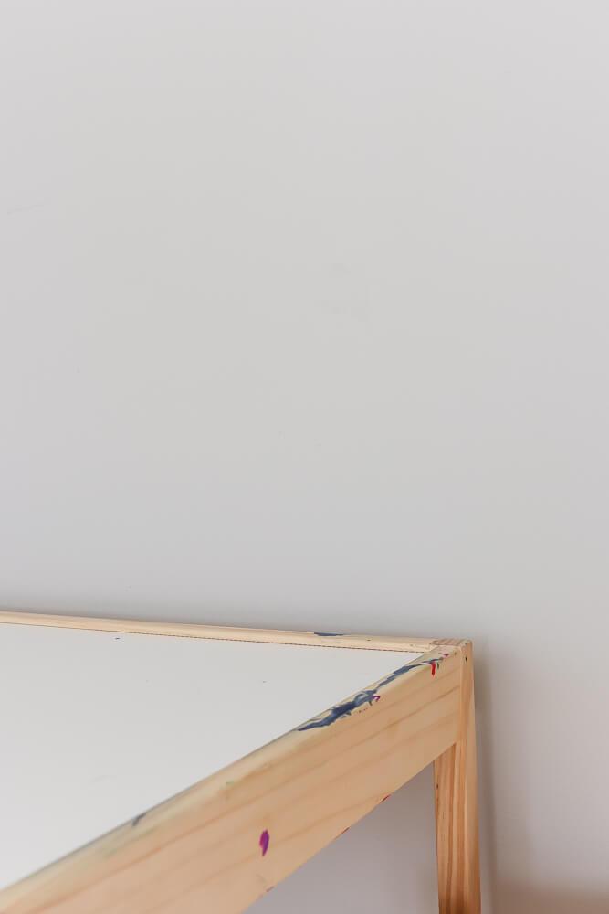 Ikea Latt table against a gray wall