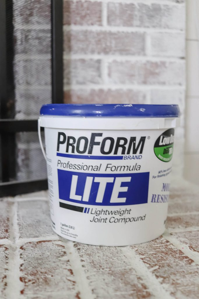 tub of ProForm lite joint compound sitting on fireplace