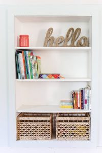 bookshelves with Hello in cursive on top