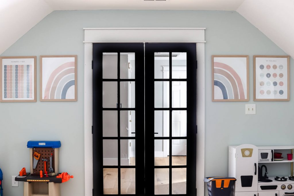 black french doors and printable wall art in playroom