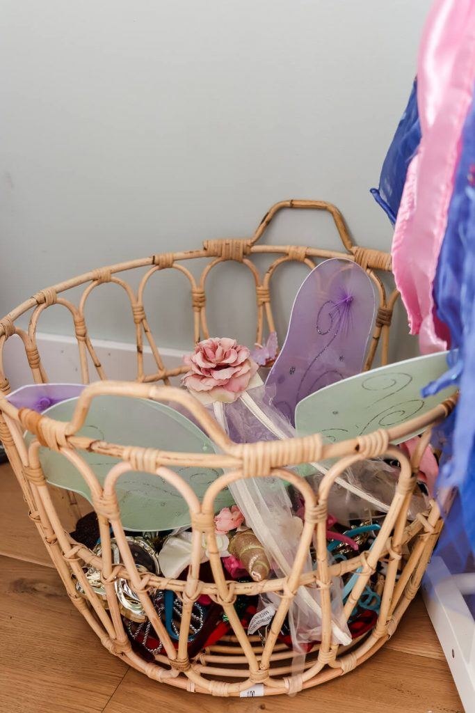 closeup of rattan basket with dress up accessories