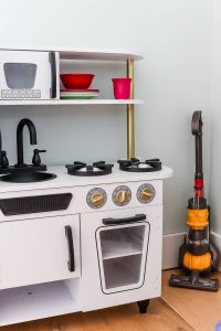 white Kidkraft kitchen spray painted and dyson in the corner