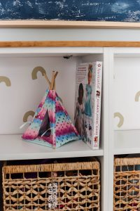 closeup of American Girl book and teepee for dolls